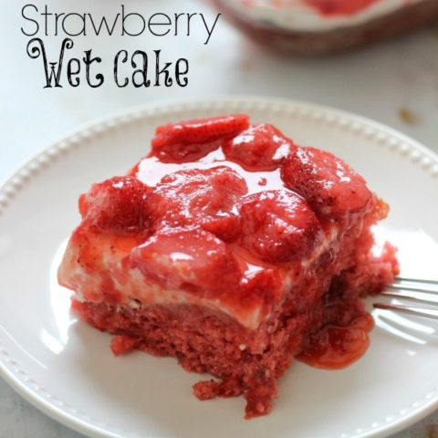 Strawberry Wet Cake - A super moist strawberry cake filled with real strawberries and strawberry jello and topped with a wonderful cream cheese icing and more strawberries!! It's perfect for a crowd!