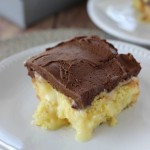 Boston Cream Pie Poke Cake - Major crowd-pleasing cake filled with vanilla pudding and sweetened condensed milk and topped with a homemade chocolate frosting!!