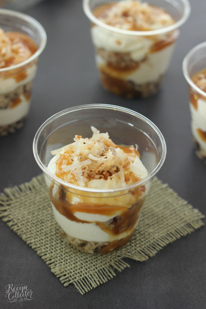 Coconut & Caramel Pecan Parfait - A decadent dessert filled with layers of pecan cookie crust, toasted coconut, cream cheese filling, and caramel. It would be perfect as a trifle dish too!
