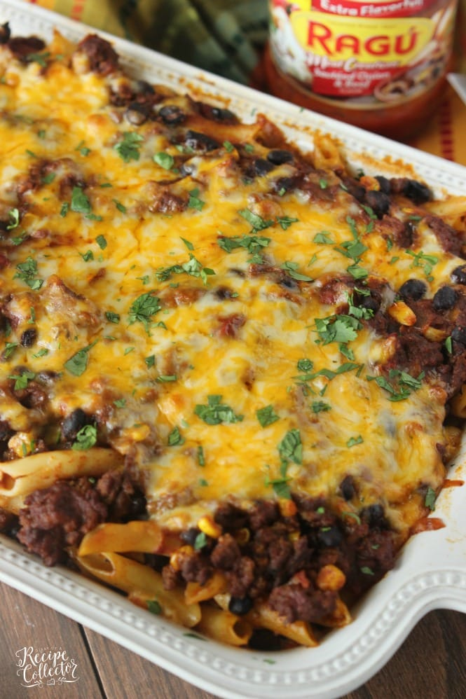 Mexican Baked Ziti – A comforting casserole filled with pasta, ground beef, cheese, Ragu sauce, black beans, and corn.
