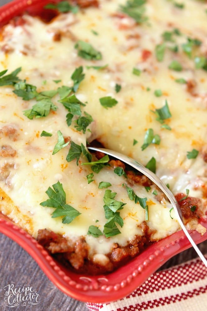 Italian Ravioli Pasta Bake - Layers of meat sauce, cheese ravioli, spinach, and cheese baked up to perfection.