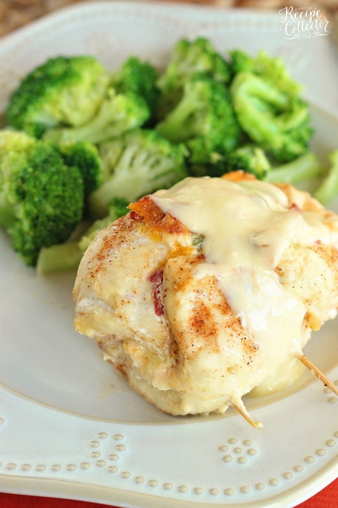Stuffed Cream Cheese Chicken - Chicken breasts filled and rolled up with a delicious cream cheese spread and baked in the oven. They are such a nice change from the usual chicken dinner!