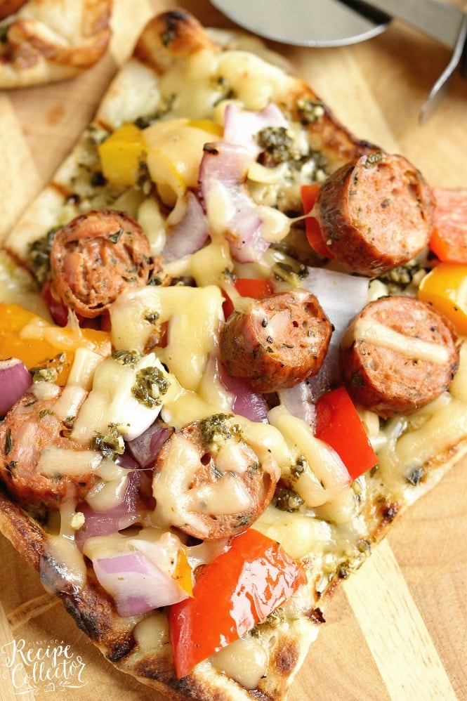 Grilled Sausage & Pepper Pizza - Grill your pizza and top it with delicious Italian Style Smoked Chicken Sausage, peppers, onions, basil pesto, and Fontina cheese.