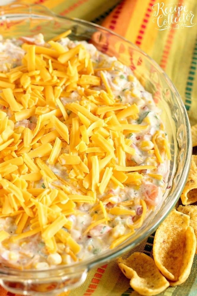 Fiesta Corn Dip - This corn dip version has that spicy-sweet kick with the help of pepper jelly, whipped cream cheese, and pico de gallo! It's a great make ahead dip recipe idea too!