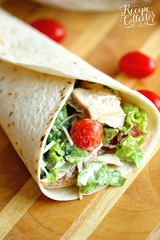 Chicken Caesar Wrap - A quick and easy lunch or dinner recipe filled with grilled chicken, chopped romaine, grape tomatoes, Parmesan cheese, and caesar dressing.  They are great to make ahead for your week too!