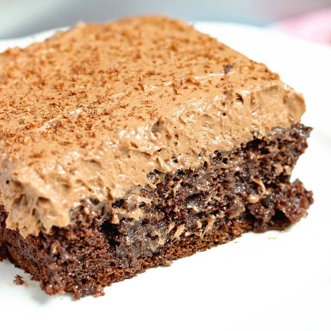 Double Mocha Poke Cake - An easy poke cake recipe using a box cake mix doctored up with pudding mix, sweetened condensed milk and expresso powder. It's topped with a heavenly mocha pudding whipped icing!