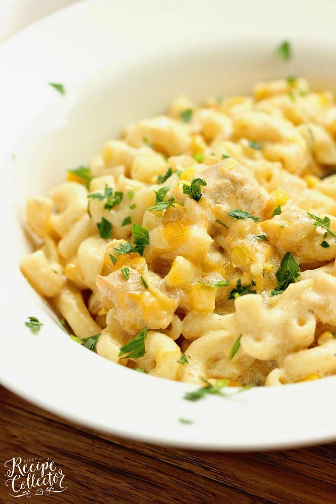 Green Chile Chicken Mac and Cheese - This hearty all-in-one macaroni and cheese dinner idea is filled with chicken, green chiles, corn, and of course all the creamy cheese!