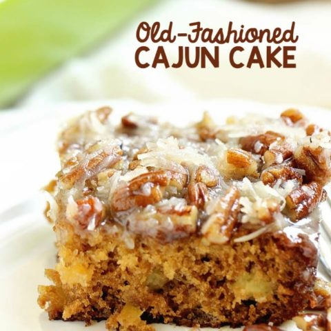 Old-Fashioned Cajun Cake - An EASY cake recipe filled with crushed pineapple and topped with a warm coconut pecan glaze.