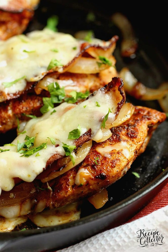 Loaded Blackened Chicken - Seasoned, pan-fried chicken breasts topped with smothered onions, bacon, and pepper jack cheese.  You'll definitely want to make this chicken dinner recipe very soon!