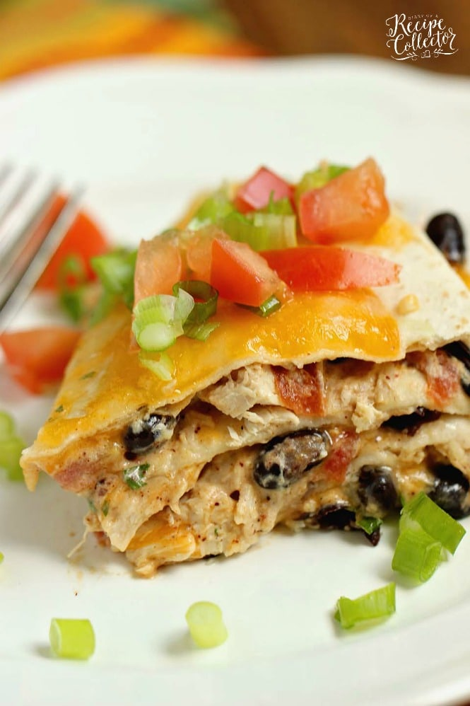 Santa Fe Chicken Enchilada Stack - Creamy chicken enchiladas  with black beans made easy!  Makes a small portion, so it's perfect for 4! Use shortcut rotisserie chicken to speed things up even more!!