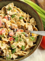Southwestern Pasta Salad - A creamy pasta salad filled with grilled chicken, black beans, corn, tomatoes, green chiles, cilantro, green onions, and Mexican spices.