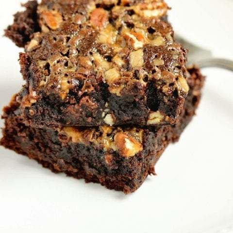 Turtle Brownies - Take your box brownie mix to the next level of good by adding toffee bits, mini chocolate chips, chopped pecans, and a drizzle of caramel topping. They are decadent!