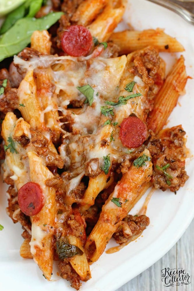 Easy One Pot Pizza Pasta - A quick and delicious dinner idea filled with ground beef, mini pepperoni, Italian spices, pasta, and cheese.