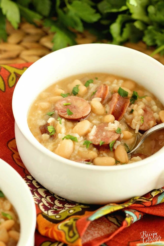 Instant Pot White Beans, Sausage, and Rice - It only takes minutes and a few ingredients to make this easy all in one pot meal filled with smoked sausage, white beans, rice, and some spice.