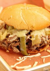 Slow Cooker Southern Cheesesteak Sandwiches - Shredded beef, onions, and peppers piled high with Pepper Jack cheese and served on a toasted kaiser roll. This is an easy and delicious dinner recipe you must try soon!