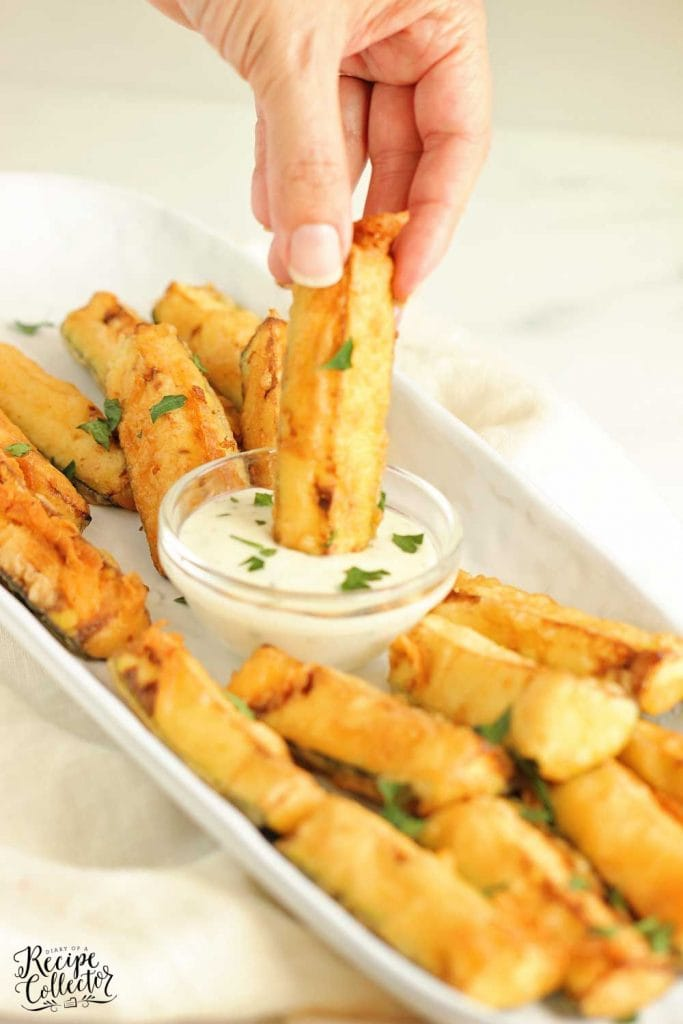 Cajun Fried Zucchini - This easy recipe uses one bowl to prep a delicious cold water Cajun batter. Serve them warm with your favorite ranch dressing!