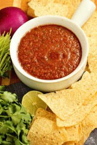 Easy Blender Salsa Recipe - This restaurant-style salsa recipe is so quick and easy and only takes 10 minutes to make!