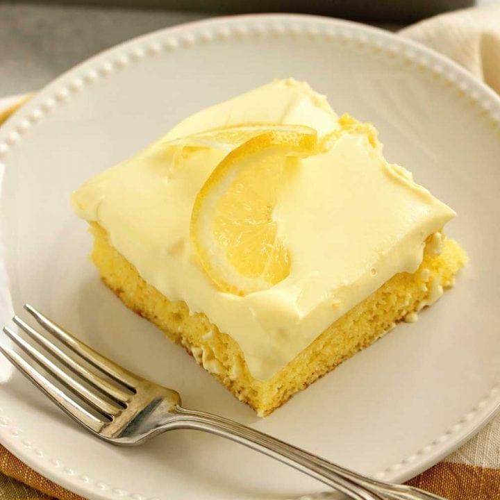 Triple Lemon Poke Cake - An easy lemon cake baked with lemon curd, filled with more lemon curd, and topped with a lemon pudding icing.