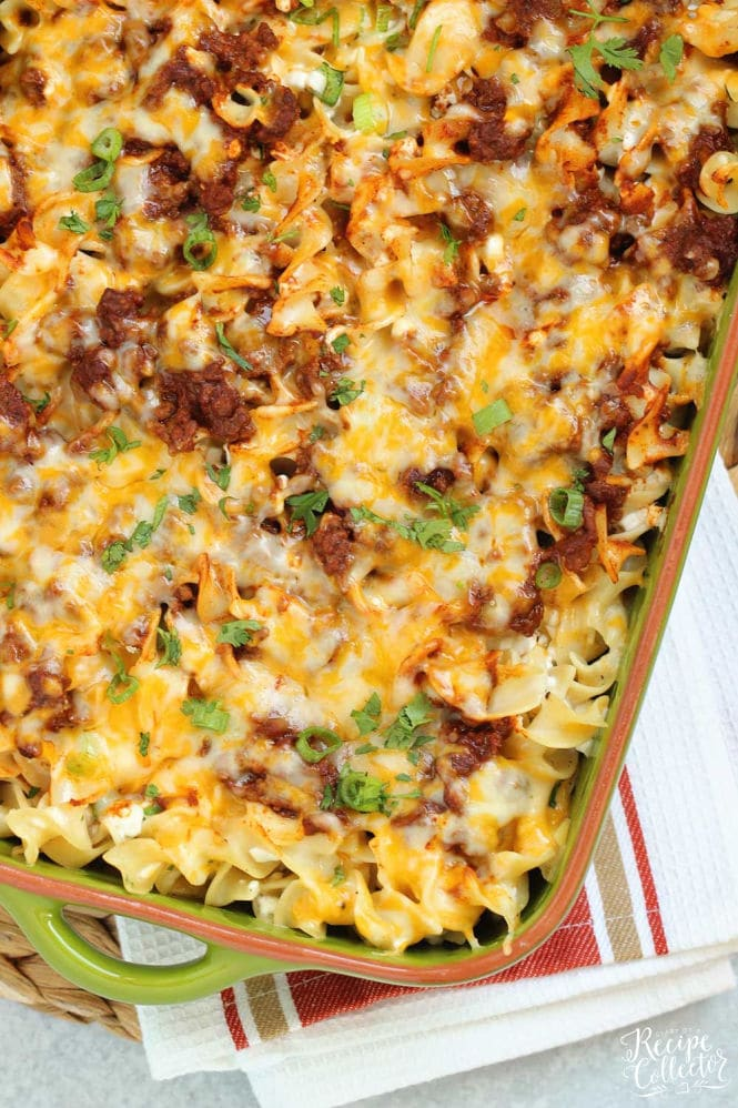 Mexican Noodle Bake - An easy layered casserole filled with seasoned ground beef, a Mexican flavored sauce, cheesy noodles, and topped with shredded cheese. You will not be slaving away on this delicious meal, I promise!