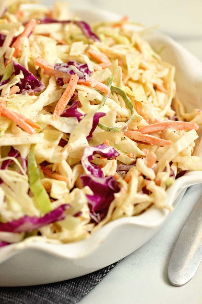 Easy Creole Coleslaw - This quick and easy coleslaw is packed with Cajun Creole flavors and only takes a few ingredients to make!