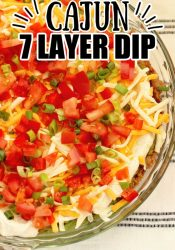 Cajun 7 Layer Dip - Layers of refried beans, black-eyed peas, guacamole, cajun sour cream, and Tony Chachere's Creole Seasoning topped with red bell peppers, tomatoes, green onions, and shredded cheese.